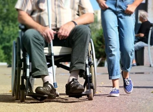 carer and client walking together